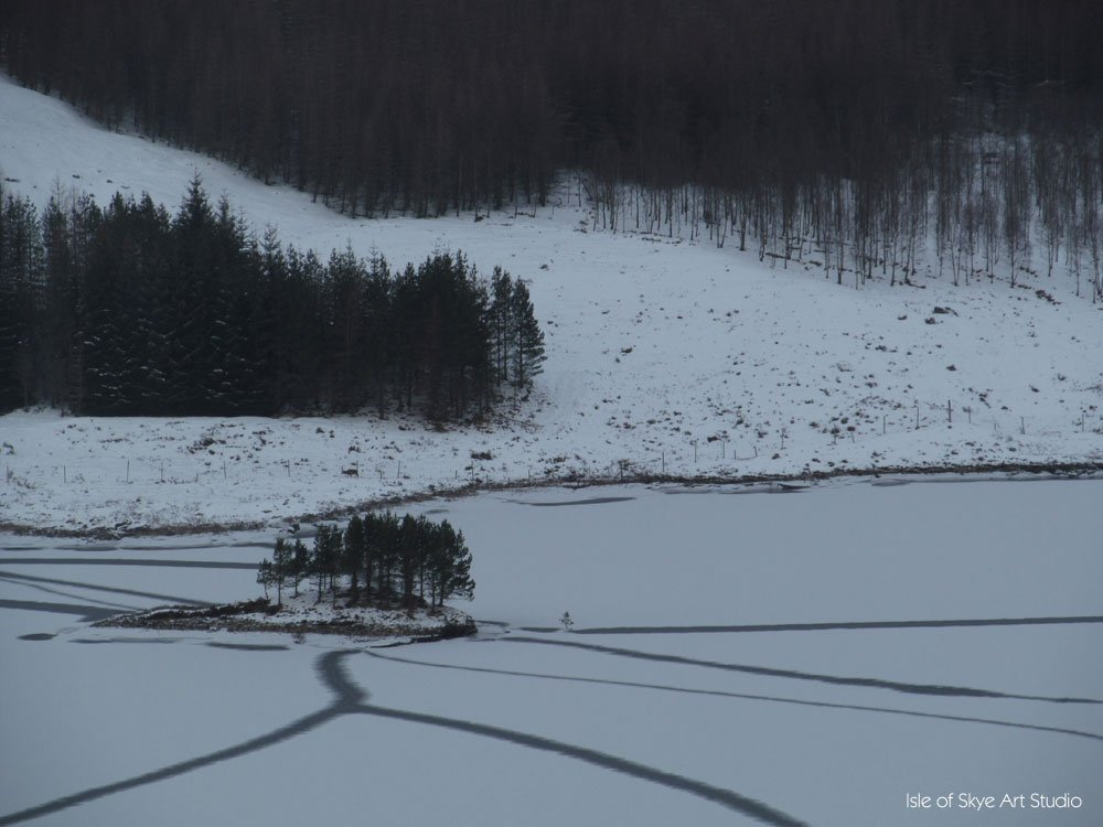 Those aren't sheep or deer tracks, but cracks in ice on a loch