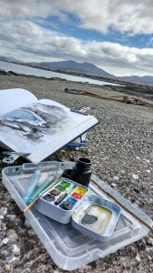 Sketching at the old pier Broadford Isle of Skye Scotland