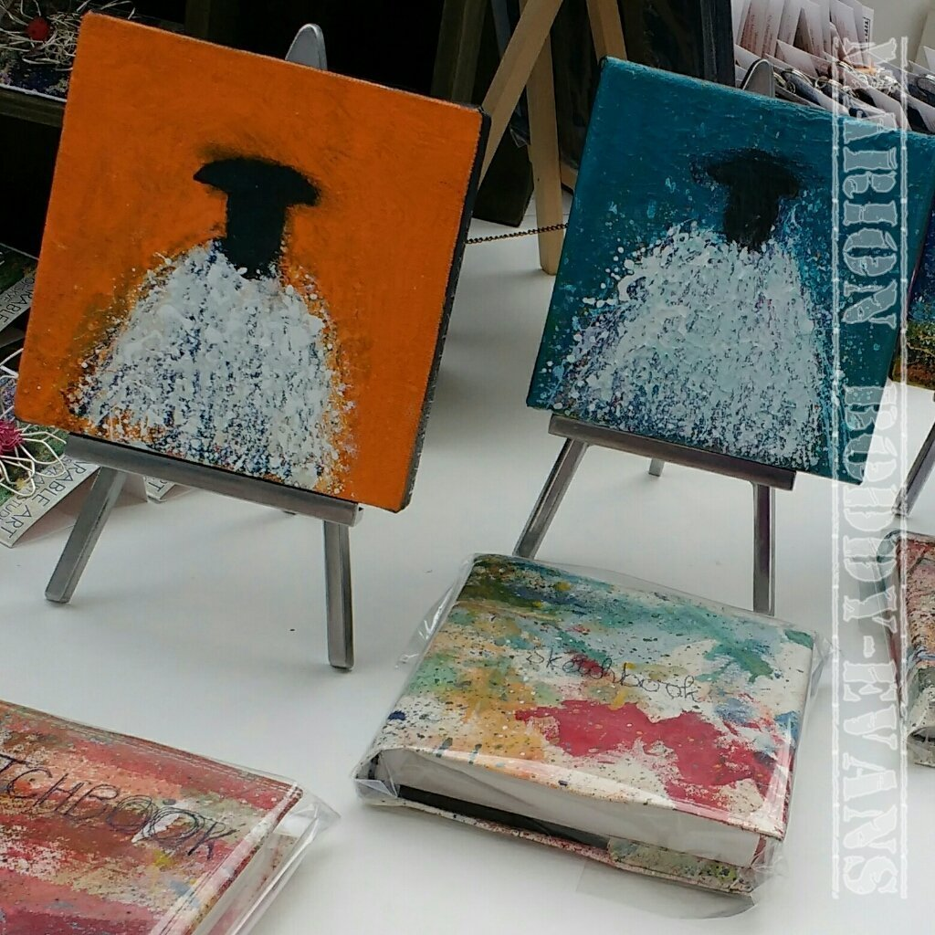 Sheep paintings and dropcloth-covered sketchbooks.