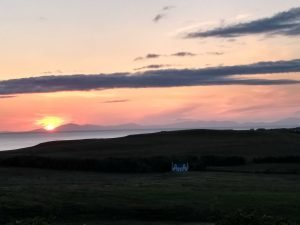 Pink sunset over the Minch Photo