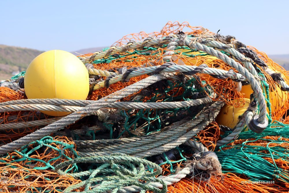 uig pier pile nets yellow buoy