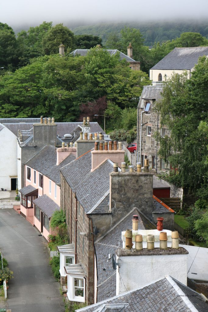 Buildings at Portree Harbour with multiple chimneys
