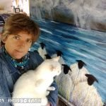 Marion-Boddy-Evans artist with her white cat