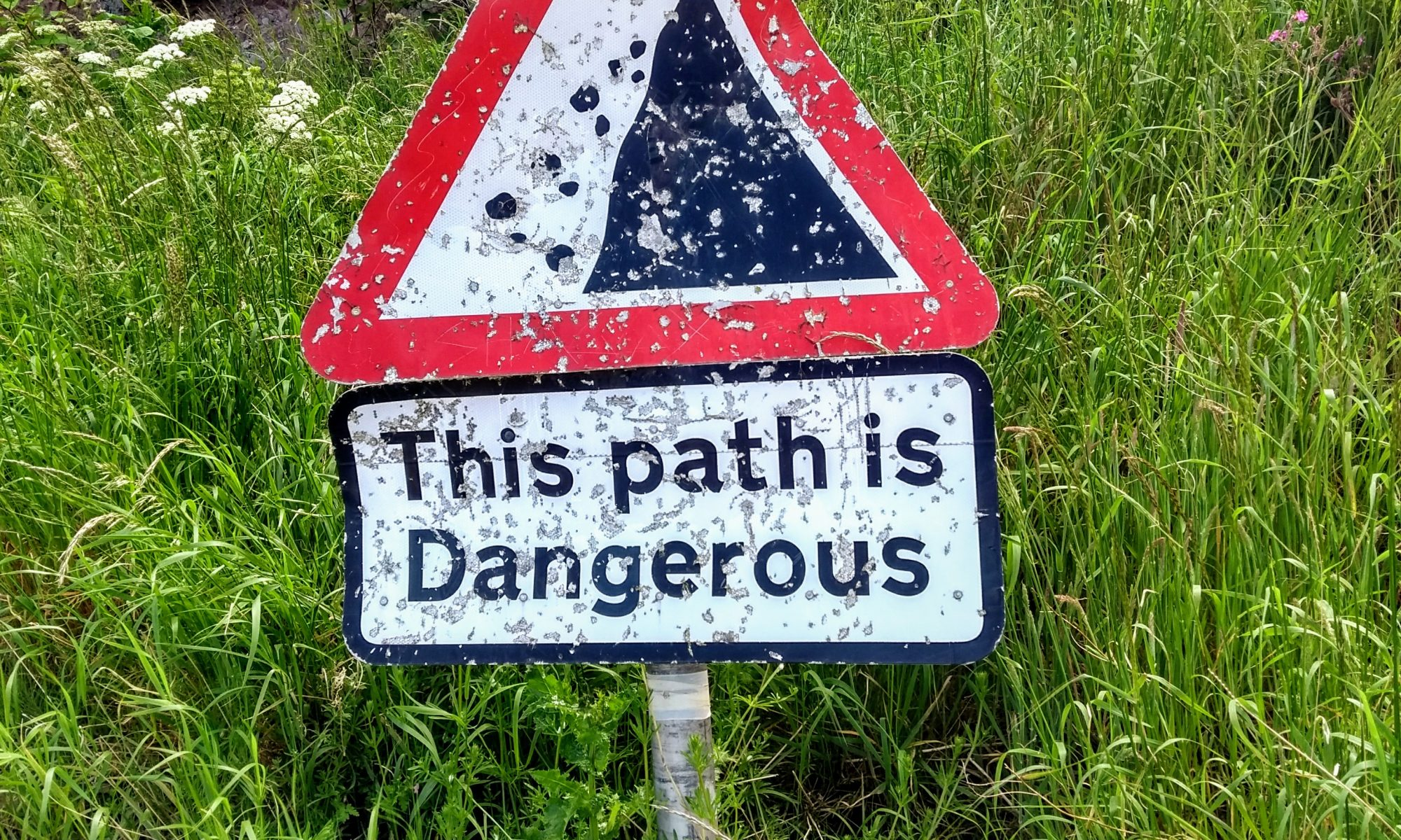 Sign that reads this path is dangerous