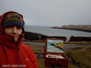 Artist Marion Boddy-Evans plein-air painting at Aird bay on Skye