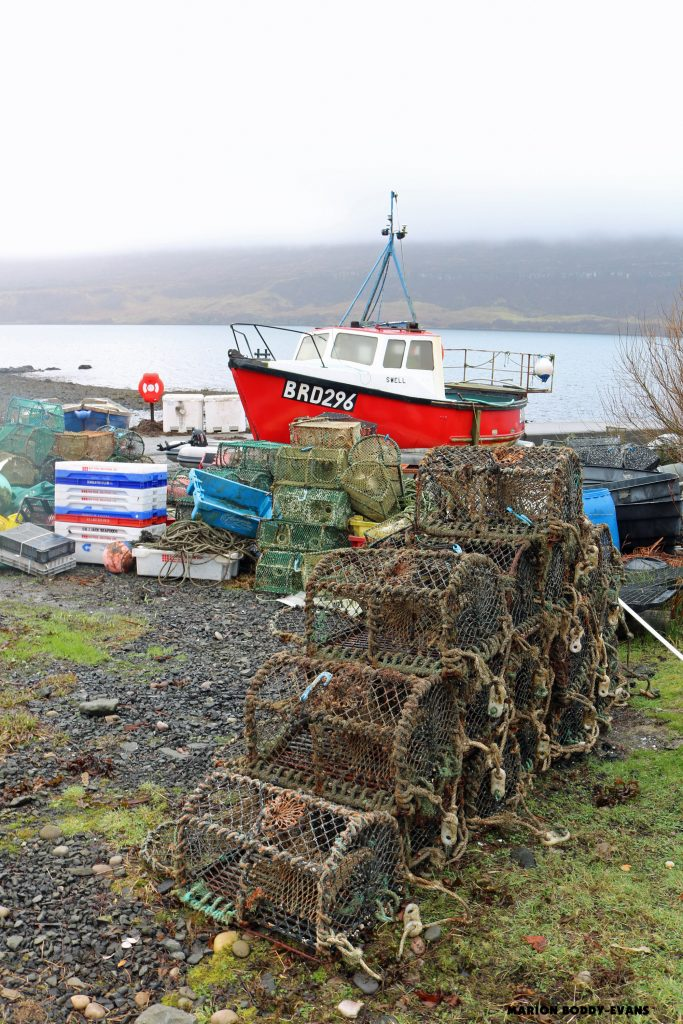 Red fishing boat and kreel nets