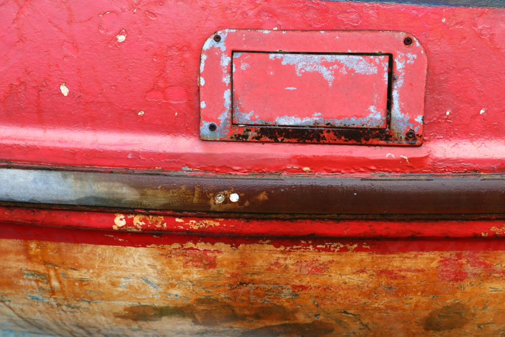 Abstract detail from a red boat