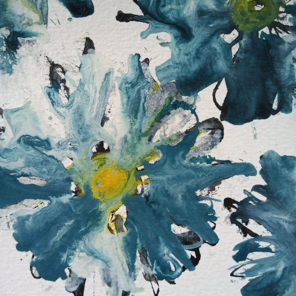 blue and white daisies painted on paper