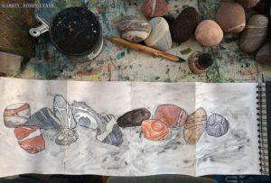 Drawing pebbles in an octopus sketchbook
